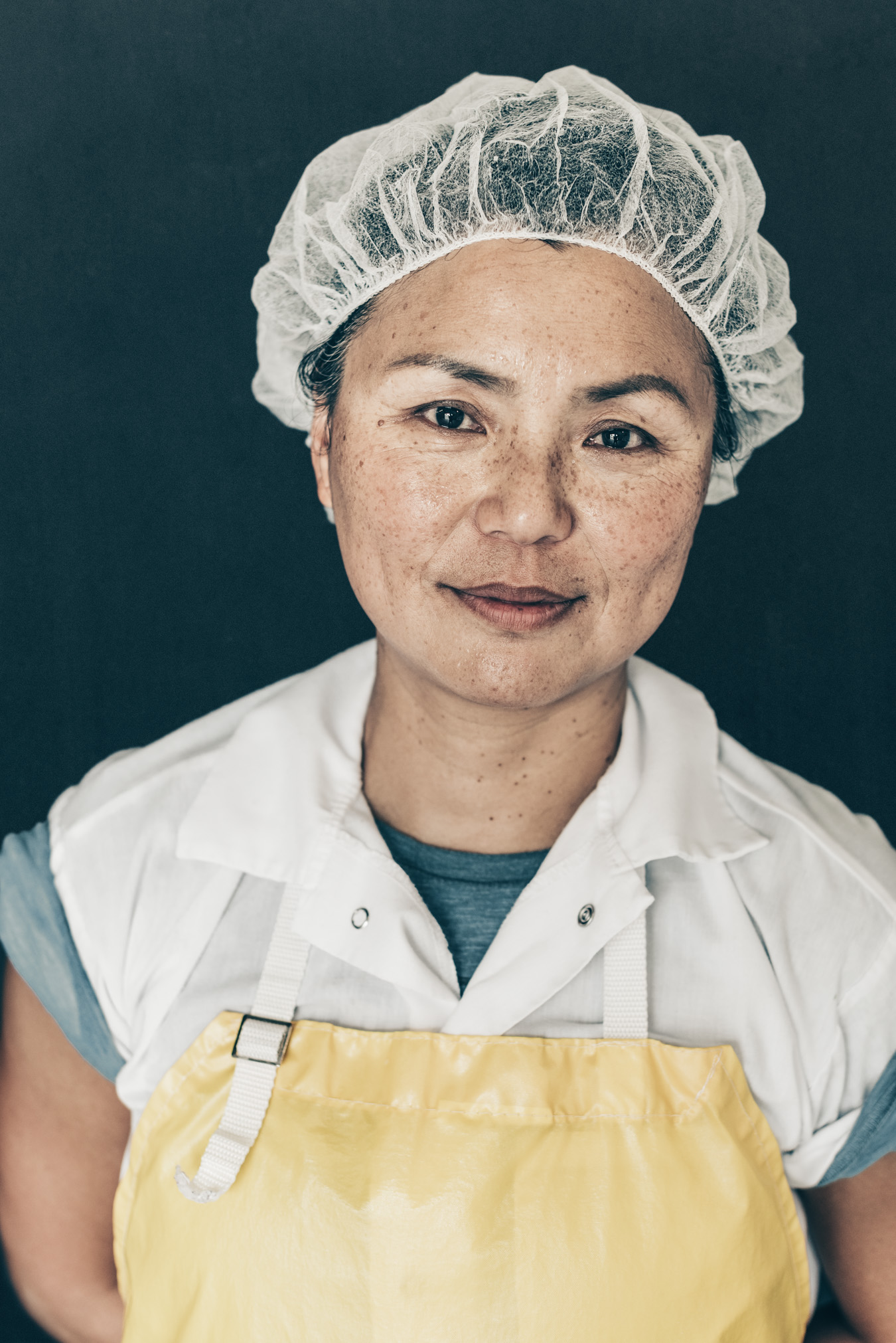 Haystack dairy goat cheese maker woman portrait